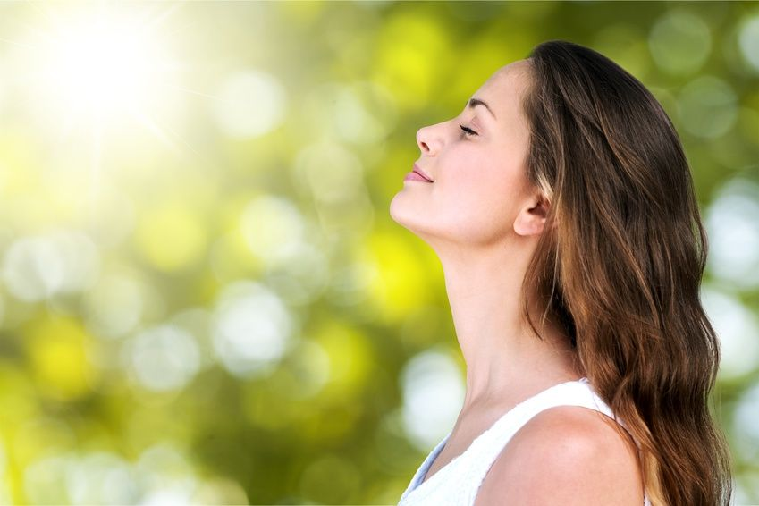 woman breathing fresh clean air