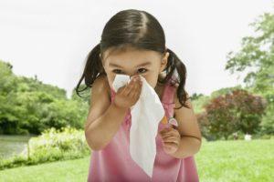 5 ways to alleviate seasonal allergy symptoms-little girl sneezing outdoors